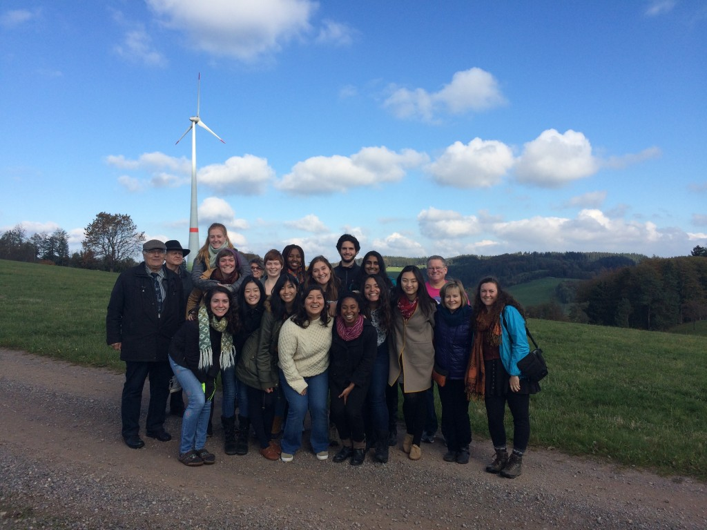 Class photo in front of a windmill and blue skies