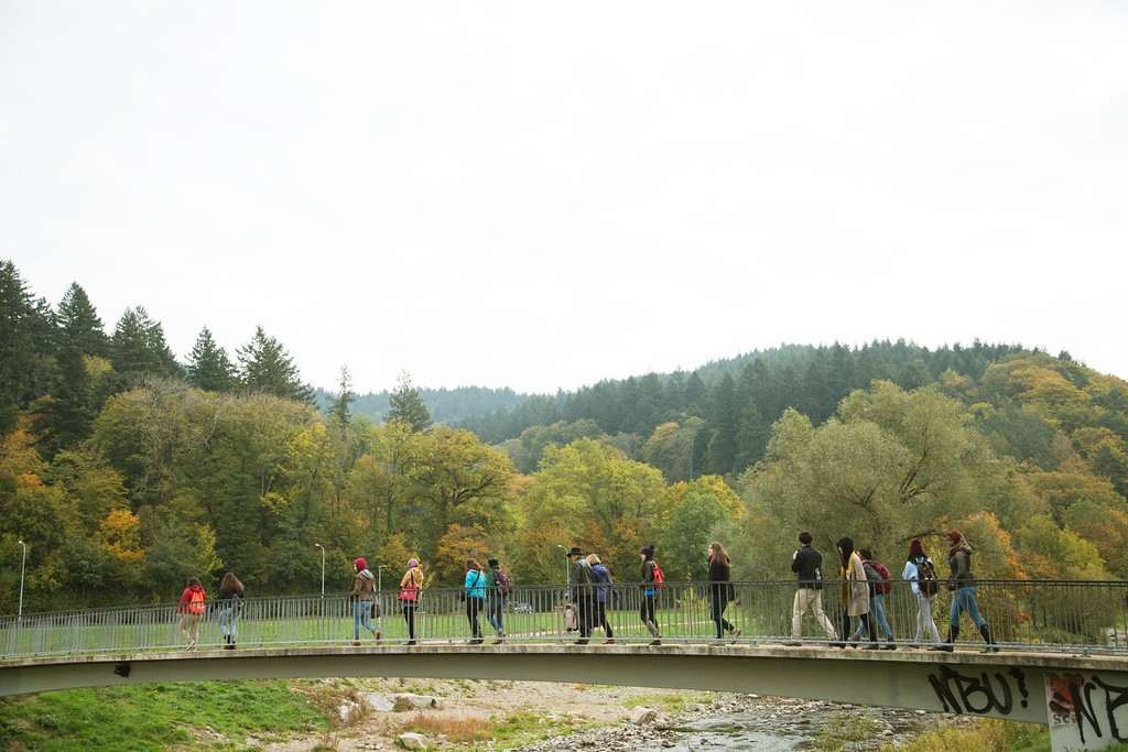 Students cross the Dreisam River